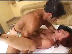Redhead mature enjoys a young cock in ass and pussy